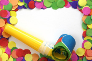 Party blower and  colorful confetti on white background - carnival frame