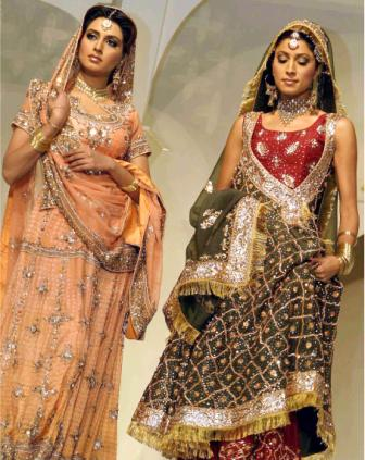 "Pakistani models walk the ramp during a fashion show entitled ""Essentially Pakistan-Virasat Kay Sab Rang""  in Lahore, 16 August 2005. The models were displaying the creations of designer Hassan Sheheryar Yasin.  AFP PHOTO/Arif ALI"