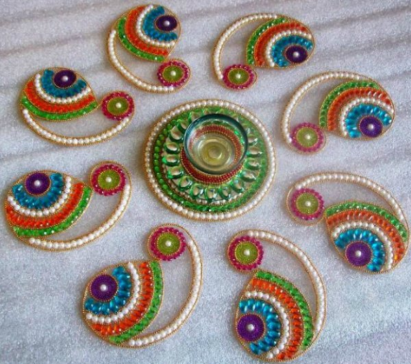 Latest rangoli designs for diwali starsricha for Home made rangoli designs